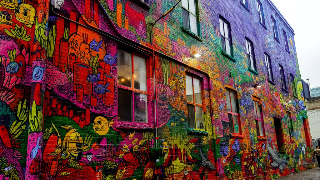 Graffiti all over the walls in this alley.